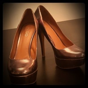 Lustrous pink Aldo 5.5 inch platform heels